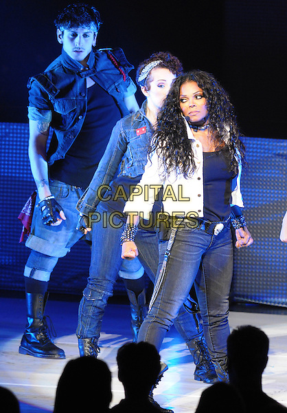 "Janet Jackson.Janet Jackson performs during her ""Number Ones: Up Close and Personal"" World Tour, Hamilton, Ontario, Canada, .3rd August 2011..half 3/4  length jeans dancing concert gig live on stage white shirt jacket singing  skull belt black grey gray dancers .CAP/ADM/BPC.©Brent Perniac/AdMedia/Capital Pictures."