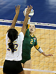 SIOUX FALLS, SD - DECEMBER 8:  Morgan Hooe #2 from Alaska Anchorage battles for the ball with Tulani Titley #22 from Angelo State in the Women's Division II Volleyball Championship Thursday at the Sanford Pentagon in Sioux Falls, SD.  (Photo by Dave Eggen/Inertia)