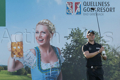 22.09.2016. Bad Griesbach, Germany, PGA European Tour, round 1.  Martin Kaymer of Germany  stands in front of a poster of a woman in traditional costume holding up a liter of beer at the European Tour - European Open in golf in Bad Griesbach, Germany, 22 September 2016.