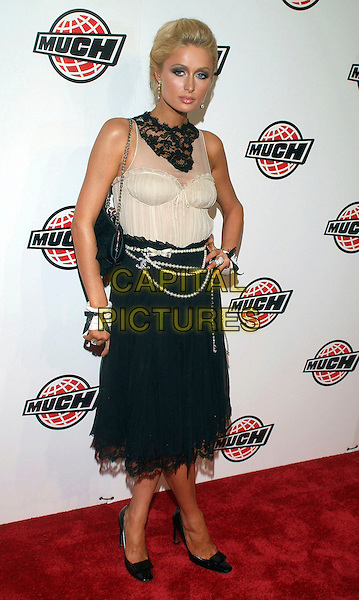 PARIS HILTON.17th Annual MuchMusic Video Awards, CHUM City Building, Toronto, Ontario, Canada, USA..June 18th, 2006.Photo: Brent Perniac/AdMedia/Capital Pictures.Ref: BP/ADM.full length white black lace sleeveless pearl belt necklace chain purse bag skirt .www.capitalpictures.com.sales@capitalpictures.com.© Capital Pictures.