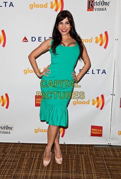 Mayra Veronica.23rd Annual GLAAD Media Awards - Arrivals held at Westin Bonaventure Hotel, Los Angeles, California, USA..April 21st, 2012.full length green dress  hands on hips.CAP/ADM/ES.©Emiley Schweich/AdMedia/Capital Pictures.