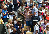 A spectator is escorted out after fainting on Centre Court<br /> <br /> Photographer Ashley Western/CameraSport<br /> <br /> Wimbledon Lawn Tennis Championships - Day 11 - Friday 14th July 2017 -  All England Lawn Tennis and Croquet Club - Wimbledon - London - England<br /> <br /> World Copyright &copy; 2017 CameraSport. All rights reserved. 43 Linden Ave. Countesthorpe. Leicester. England. LE8 5PG - Tel: +44 (0) 116 277 4147 - admin@camerasport.com - www.camerasport.com