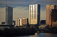 Close up of the modern condos and high rise office towers that line the shore of Lady Bird Lake in Austin, Texas