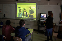 Senior students watch an MIT Blossoms video about exponential growth in Sandra Haupt's Intro to Calc class at Concord-Carlisle Regional High School in Concord, MA, USA. The class has partnered with MIT Blossoms to use video education tools in conjunction with regular lessons to reinforce key concepts.