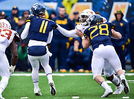 Morgantown, WV - NOV 18, 2017: Texas Longhorns defensive end Malcolm Roach (32) makes a game changing play with a turnover sack against West Virginia Mountaineers quarterback Chris Chugunov (11) during game between West Virginia and Texas at Mountaineer Field at Milan Puskar Stadium Morgantown, West Virginia. (Photo by Phil Peters/Media Images International)