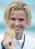 Germany's Britta Steffen shows the gold medal after setting the new world record clocking 23.73 in the Women's 50m Freestyle final at the Swimming World Championships in Rome, 2 August 2009..UPDATE IMAGES PRESS/Riccardo De Luca