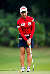 Mi-Hyang Lee of Korea plays a shot during the Hyundai China Ladies Open 2014 on December 10 2014 at Mission Hills Shenzhen, in Shenzhen, China. Photo by Li Man Yuen / Power Sport Images