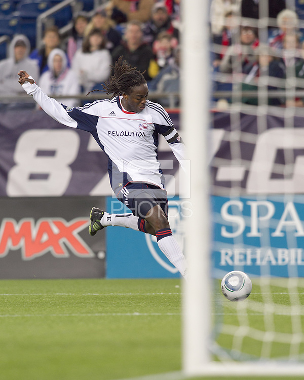 New England Revolution midfielder Shalrie Joseph (21) on the attack. In a Major League Soccer (MLS) match, the New England Revolution tied the Portland Timbers, 1-1, at Gillette Stadium on April 2, 2011.
