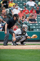 Umpire John Bacon and Indianapolis Indians catcher Jacob Stallings (23) during a game against the Rochester Red Wings on May 26, 2016 at Frontier Field in Rochester, New York.  Indianapolis defeated Rochester 5-2.  (Mike Janes/Four Seam Images)