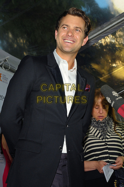 "Joshua Jackson.""Inescapable"" Premiere - 2012 Toronto International Film Festival held at Ryerson Theatre, Toronto, Ontario, Canada..September 11th, 2012.TIFF half black white shirt blue suit smiling interview microphone .CAP/ADM/BPC.©Brent Perniac/AdMedia/Capital Pictures."