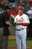 Springfield Cardinals manager Dann Bilardello (11) talks with umpire Jake Wilburn during a game against the Frisco RoughRiders  on June 4, 2015 at Hammons Field in Springfield, Missouri.  Frisco defeated Springfield 8-7.  (Mike Janes/Four Seam Images)