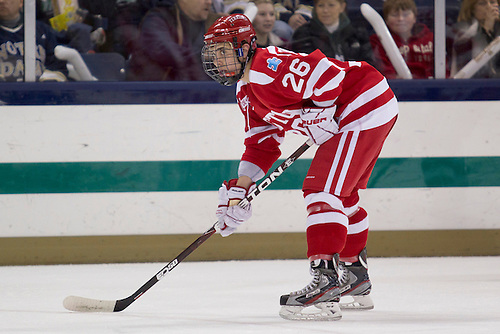 Boston University forward Evan Rodrigues (#26) in first period action of NCAA hockey game between Notre Dame and Boston University.  The Notre Dame Fighting Irish defeated the Boston University Terriers 5-2 in game at the Compton Family Ice Arena in South Bend, Indiana.