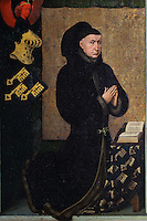 Nicolas Rolin kneeling in prayer, from the closed panels of the polyptych altarpiece, 1446-52, by Rogier van der Weyden, 1399-1464, commissioned by Nicolas Rolin in 1443, in Les Hospices de Beaune, or Hotel-Dieu de Beaune, a charitable almshouse and hospital for the poor, built 1443-57 by Flemish architect Jacques Wiscrer, and founded by Nicolas Rolin, chancellor of Burgundy, and his wife Guigone de Salins, in Beaune, Cote d'Or, Burgundy, France. The altarpiece was originally in the Chapel, but is now in the museum. The panels were only opened to patients during holy days. The hospital was run by the nuns of the order of Les Soeurs Hospitalieres de Beaune, and remained a hospital until the 1970s. The building now houses the Musee de l'Histoire de la Medecine, or Museum of the History of Medicine, and is listed as a historic monument. Picture by Manuel Cohen
