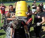 (Lowell MA 06/14/15) Reading coach Jill McElroy, gets soaked from her players after winning the MIAA Division 2 State Final game, Sunday, June 14, 2015, at Martin Park in Lowell. Herald Photo by Jim Michaud