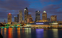 JANUARY 25, 2017 - TAMPA, FLORIDA:  The bridges along Tampa's Riverwalk are illuminated as the sun sets on the skyline of downtown Tampa, Florida. (Photo by Matt May/Alamy)