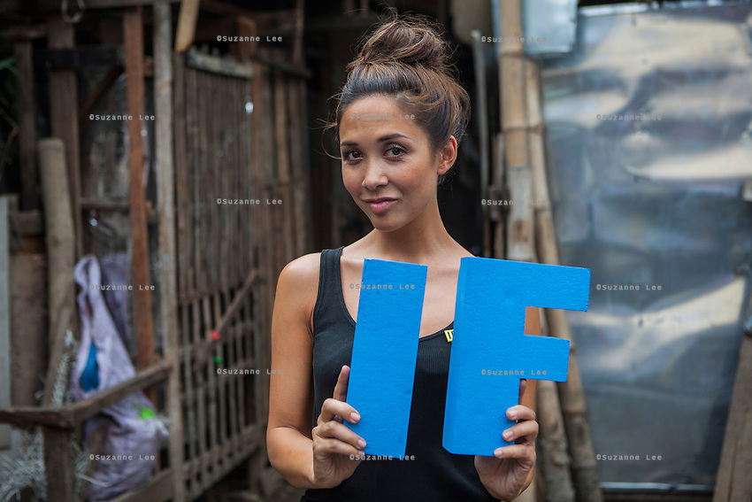 Myleene Klass, a high profile UK celebrity, TV host, violinist and pianist, holds the IF letters for the IF campaign, photographed in Paranaque, Metro Manila, The Philippines on 18 January 2013. Photo by Suzanne Lee for Save the Children UK