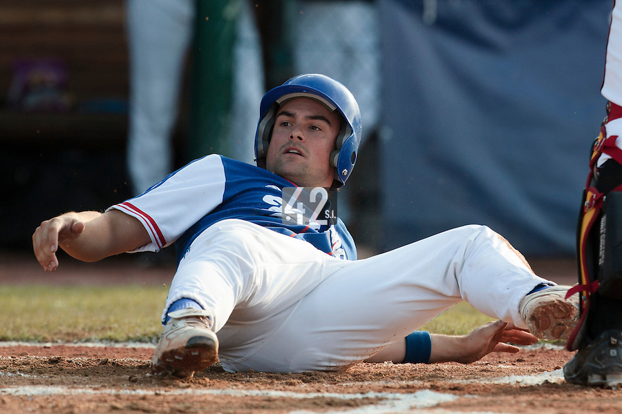 27 july 2010: Florian Peyrichou of France looks dejected after he slides into home plate and is out during Germany 10-9 victory over France, in day 5 of the 2010 European Championship Seniors, in Stuttgart, Germany.
