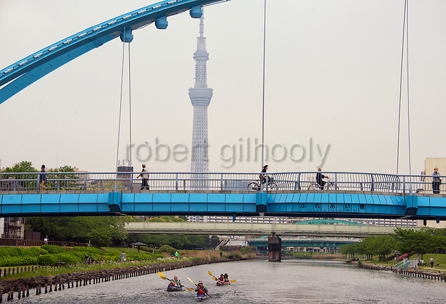 Kayakers paddled below Fureai Bridge that spans the Onagigawa River in Koto Ward, Tokyo, Japan. ROB GILHOOLY