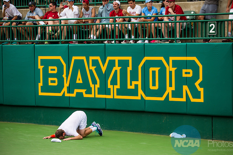 19 MAY 2015:  Mitchell Frank of the University of Virginia kisses the court after winning his match against Oklahoma's Andrew Harris and clinching The Division I Men's Tennis Championship at the Hurd Tennis Center on the Baylor University campus in Waco, TX.  Virginia defeated Oklahoma 4-1 to win the team national title.  Darren Carroll/NCAA Photos