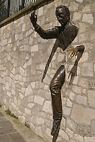 Paris, Statue of Le Passe-Muraille (Man Who Could Walk Through Walls), locate at Place Marcel Ayme in Paris 18 Montmartre (Avenue Junot).  Visitors often touch his hand for good luck.