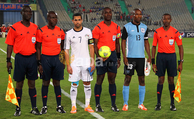 Egypt's players line-up prior to their Africa Cup of Nations 2015 qualifying football match against Botswana at Cairo stadium in the Egyptian capital on October 15, 2014. Egypt won the match with 2-0. Photo by Amr Sayed