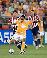 Houston Dynamo midfielder Ricardo Clark (13) passes the ball out of reach of Chivas USA forward Ante Razov (9).  The Houston Dynamo tied CD Chivas USA 0-0 at Robertson Stadium in Houston, TX on May 3, 2008.