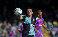 Michael Harriman of Wycombe Wanderers keeps eyes on the ball during the Sky Bet League 2 match between Wycombe Wanderers and Plymouth Argyle at Adams Park, High Wycombe, England on 12 September 2015. Photo by Andy Rowland.