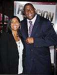 "HOLLYWOOD, CA. - January 11: Earvin ""Magic"" Johnson and Cookie Johnson  attend the ""The Book Of Eli"" Los Angeles Premiere at Grauman's Chinese Theatre on January 11, 2010 in Hollywood, California."