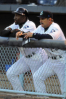 Asheville Tourists manager Joe Mikulik #20 and Hitting Coach Mike Devereaux # 12 watch thier team during a game between the Delmarva Shorebirds and the Asheville Tourists at McCormick Field, Asheville, North Carolina April 6, 2012. The Shorebirds won the game 7-2  (Tony Farlow/Four Seam Images)..