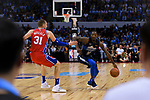 Dorian Finney Smith of Dallas Mavericks (R) in action against Mike Muscala of 76ers (L) during the NBA China Games 2018 match between Dallas Mavericks and Philadelphia 76ers at Universiade Center on October 08 2018 in Shenzhen, China. Photo by Marcio Rodrigo Machado / Power Sport Images