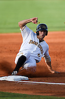 Bradenton Marauders outfielder Taylor Lewis (6) slides into third during a game against the Jupiter Hammerheads on June 25, 2014 at McKechnie Field in Bradenton, Florida.  Bradenton defeated Jupiter 11-0.  (Mike Janes/Four Seam Images)
