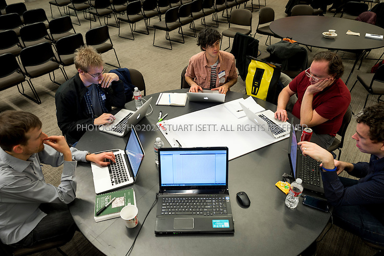 12/6/2013--Redmond, WA, USA<br /> <br /> Thatcher Collins (enter) works on his pprogram at Lincoln Lab's Seattle Hackathon. Thatcher's idea was a 'conflicts of interest checker' for politicians.<br /> <br /> Aaron Ginn, 25, is one of the three founders of Lincoln Labs along with Chris Abrams, 26 and Garret Johnson, 29 . Lincoln Labs uses such hackathons to reach out to potential Republicans and conservatives hoping to expand the party's base within the tech industry. <br /> <br /> Lincoln Lab's 'Seattle Hackathon', sponsored by Microsoft, and held in Building 92 on Microsoft's corporate headquarters in Redmond, Washington near Seattle. The theme for the hackathon was &quot;Open government&quot; with a $5000 prize to the best program built to &quot;to address critical challenges facing American governance and promote open government.&quot;<br /> <br /> Photograph by Stuart Isett<br /> &copy;2013 Stuart Isett. All rights reserved.