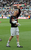 Pictured: Team captain Garry Monk of Swansea with his young son, thanking suporters after the end of the game. Saturday 07 May 2011<br /> Re: Swansea City FC v Sheffield United, npower Championship at the Liberty Stadium, Swansea, south Wales.