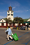 Iconic green shopping carts in use at the venerable Farmer's Market in Los Angeles, CA