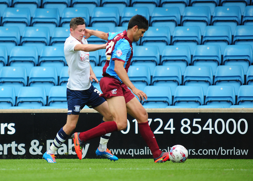 Scunthorpe United&rsquo;s Miguel &Aacute;ngel Llera shields the ball from Preston North End's Alan Browne<br /> <br /> Photographer Chris `Vaughan/CameraSport<br /> <br /> Football - The Football League Sky Bet League One - Scunthorpe United v Preston North End - Glanford Park - Scunthorpe<br /> <br /> &copy; CameraSport - 43 Linden Ave. Countesthorpe. Leicester. England. LE8 5PG - Tel: +44 (0) 116 277 4147 - admin@camerasport.com - www.camerasport.com