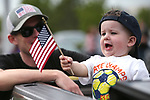 Jonathan Jacobson and his son Joseph, 18-months, wait for the start of the 4th annual Veterans Suicide Awareness March held by the Western Nevada College Veterans Resource Center, in Carson City, Nev., on Saturday, May 5, 2018. <br />