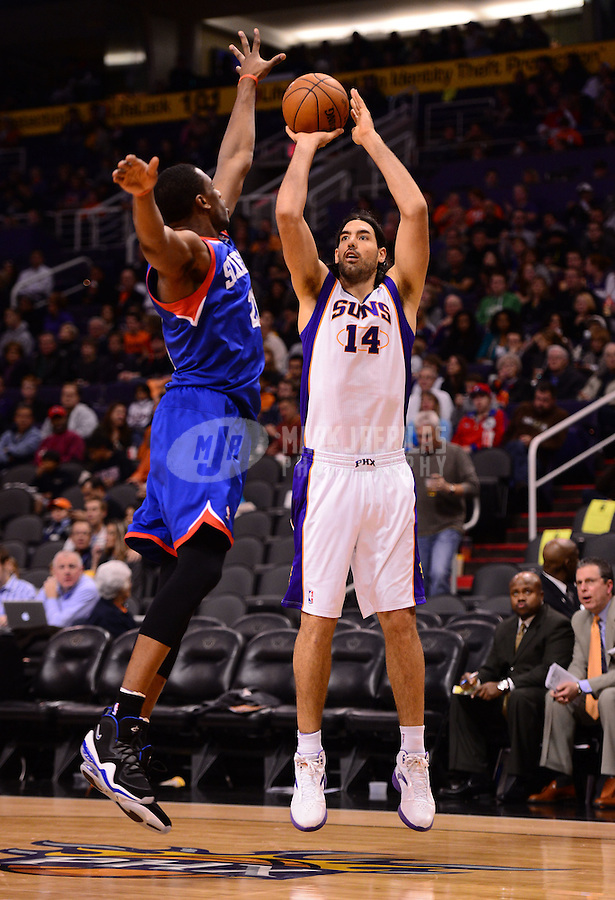 Jan. 2, 2013; Phoenix, AZ, USA: Phoenix Suns forward Luis Scola (14) takes a shot in the second half against the Philadelphia 76ers at the US Airways Center. The Suns defeated the 76ers 95-89. Mandatory Credit: Mark J. Rebilas-USA TODAY Sports