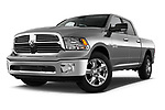 Low aggressive front three quarter view of a <br /> 2013 Dodge RAM 1500 Big Horn Crew Cab