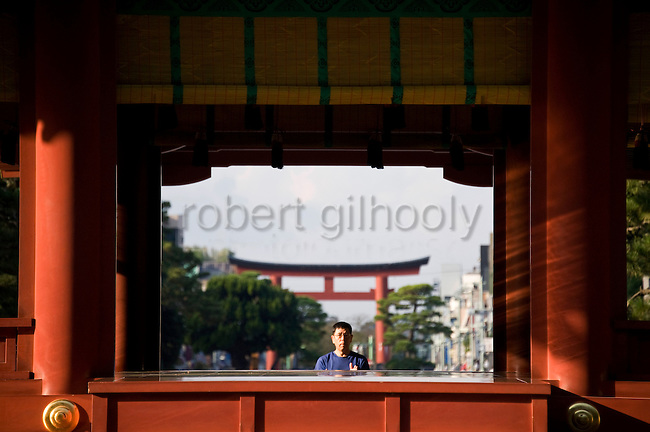 A pilgrim prays at  Tsurugaoka Hachimangu shrine on the morning of the first day of the 3-day Reitaisai grand festival in Kamakura, Japan on  14 Sept. 2012.  Photographer: Robert Gilhooly