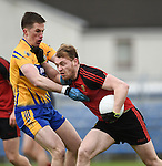 Eoin Cleary of  Clare in action against Gerard Mc Govern of Down during their Division 2, Round 2 National League game at Cusack Park. Photograph by John Kelly.