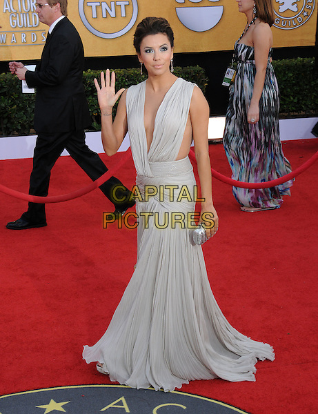 EVA LONGORIA .at the 17th Screen Actors Guild Awards held at The Shrine Auditorium in Los Angeles, California, USA, .January 30th 2011..SAG Sags arrivals full length hand waving long maxi dress grey gray pleated beige low cut sleeveless plunging neckline clutch bag silver                             .CAP/RKE/DVS.©DVS/RockinExposures/Capital Pictures.