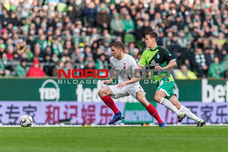 10.02.2019, Weserstadion, Bremen, GER, 1.FBL, Werder Bremen vs FC Augsburg<br /> <br /> DFL REGULATIONS PROHIBIT ANY USE OF PHOTOGRAPHS AS IMAGE SEQUENCES AND/OR QUASI-VIDEO.<br /> <br /> im Bild / picture shows<br /> Alfred Finnbogason (FC Augsburg #27) im Duell / im Zweikampf mit Niklas Moisander (Werder Bremen #18), <br /> <br /> Foto &copy; nordphoto / Ewert