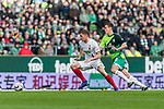 10.02.2019, Weserstadion, Bremen, GER, 1.FBL, Werder Bremen vs FC Augsburg<br /> <br /> DFL REGULATIONS PROHIBIT ANY USE OF PHOTOGRAPHS AS IMAGE SEQUENCES AND/OR QUASI-VIDEO.<br /> <br /> im Bild / picture shows<br /> Alfred Finnbogason (FC Augsburg #27) im Duell / im Zweikampf mit Niklas Moisander (Werder Bremen #18), <br /> <br /> Foto © nordphoto / Ewert