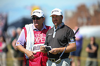 Graeme McDowell (NIR) and Ken Comboy during Round One of the 145th Open Championship, played at Royal Troon Golf Club, Troon, Scotland. 14/07/2016. Picture: David Lloyd | Golffile.<br /> <br /> All photos usage must carry mandatory copyright credit (&copy; Golffile | David Lloyd)