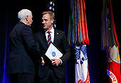 United States Vice President Mike Pence, left, and acting United States Secretary of Defense Patrick M. Shanahan, shake hands as they and US President Donald J. Trump participates in a Missile Defense Review announcement at the Pentagon, in Arlington, Virginia, January 17, 2019.<br /> Credit: Martin H. Simon / Pool via CNP