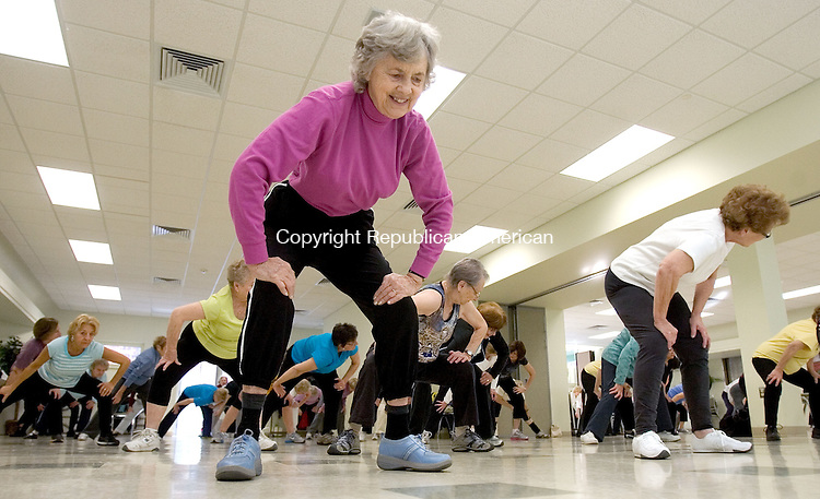 SOUTHBURY CT. 01 December 2014-120114SV03-Janet Gray of Southbury stretches during the get healthy aerobics program at the senior center in Southbury Monday. Over 50 people attend the class. <br /> Steven Valenti Republican-American
