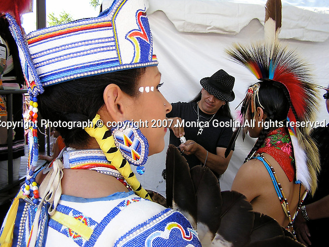 A woman and a man prepare during the costume contest at the Indian Market in Santa Fe, New Mexico.