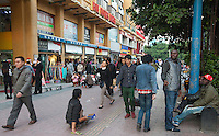 African and Chinese people are seen in an area of Guangzhou known to locals as 'Chocolate City', Guangzhou, Guangdong Province, China, 08 December 2014. The health authorities of Guangzhou are said to be stepping up their monitoring of the African community in light of the ongoing outbreak of the Ebola virus disease in West Africa.