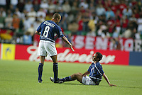 Earnie Stewart offers a hand to Landon Donovan after the game. The USA lost to Germany 1-0 in the Quarterfinals of the FIFA World Cup 2002 in South Korea on June 21, 2002.