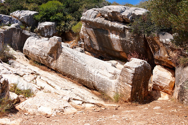 Half finished Statue of Dionysis left lying in the 7th century BC ancient quarry of  Kouros. Naxos Greek Cyclades Islands